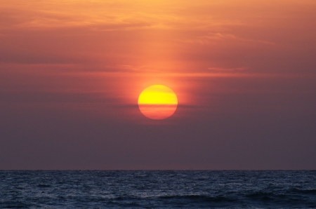 sun in the sky over the ocean, sunset Stock Photo