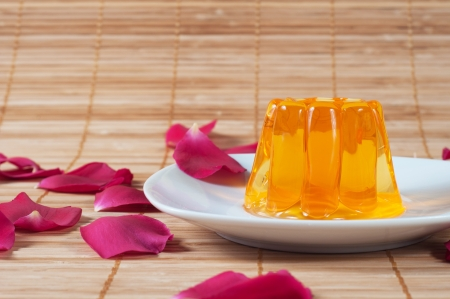 gelatine: Colorful jelly on white plates over wooden background Stock Photo