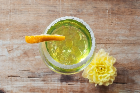 Lemon cocktail in a glass on wooden background photo