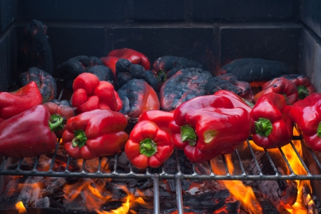 red peppers roasting on the barbecue photo