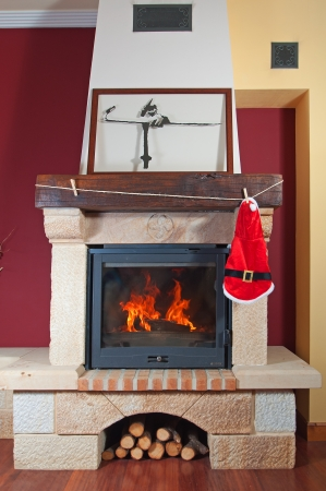 Fireplace at christmas. santa suit hanging photo