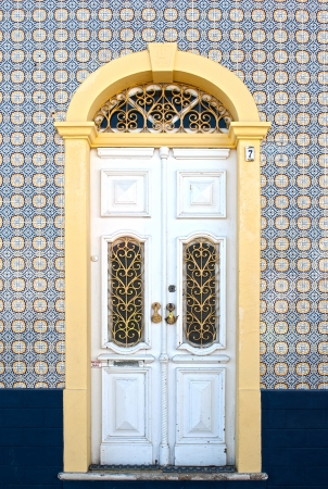 Beautiful antique door in a decorated facade photo