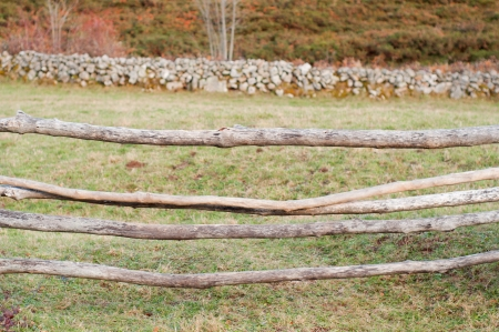 wooden barrier in a rural field photo