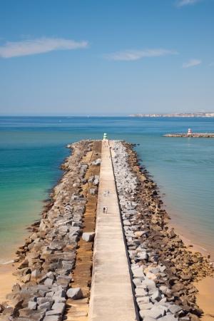 Breakwater in Algarve beach, Portugal