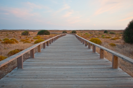 Wooden path in the dunes. Algarve, Portugal