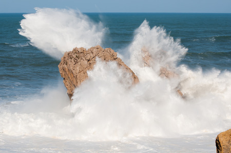 Big waves breaking against the rocks, Urros, Cantabria, Spain photo