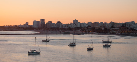 Boats at sunset in the harbor, Portimao city, Portugal Stock Photo