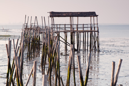 Carrasqueira, Portugal. Port made of wood, piers and cabins photo