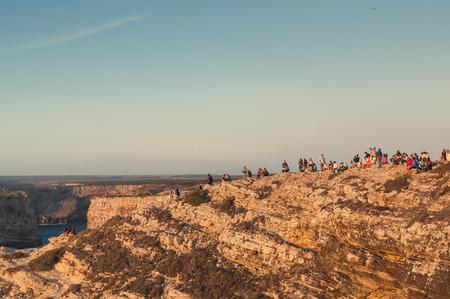 region of algarve: Cap Sao Vicente, Portugal. People watching sunset