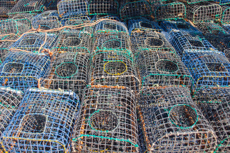 Some fishing cages stacked on the ground photo