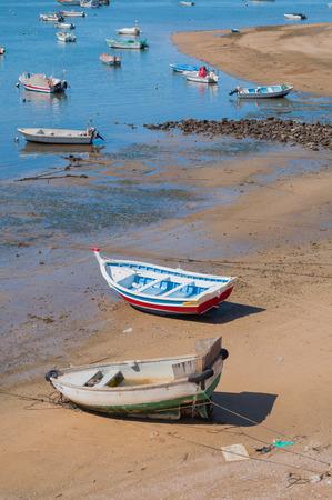 Fisher boats in the beach, Ferragudo, Portugal Stock Photo