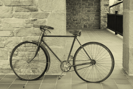 oxidized: Antique or retro oxidized bicycle outside on a stone wall