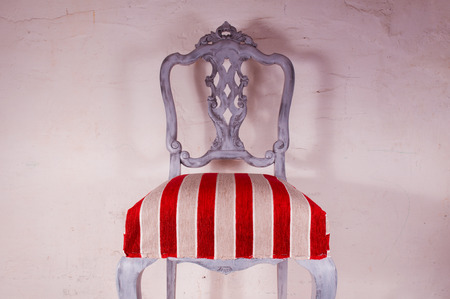 Upholstery work. Wooden chair painted with beautiful fabric photo