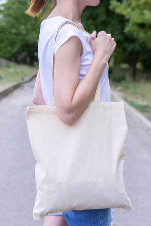 Girl with cotton bag over her shoulder