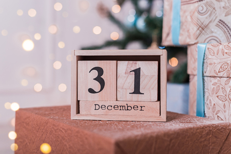 Wooden cube shaped calendar with 31 December date. Christmas decor. Stock Photo