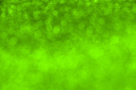 Delicate glitter bokeh Chartreuse background. Creative and moody color of the picture.
