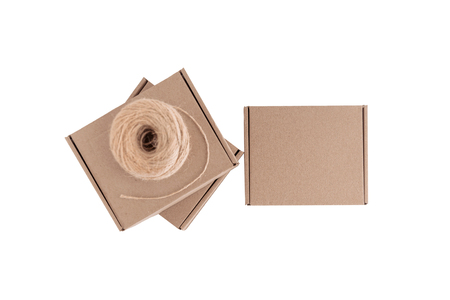 Stack of craft paper boxes and coil of rope isolated on white. Mock up.