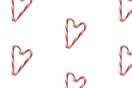 Candy canes shaped heart pattern isolated on white, top view. Flat lay. Stok Fotoğraf