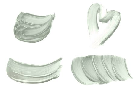 Set of abstract brush strokes toned tranquil mint green color isolated on white. Top view. Stok Fotoğraf