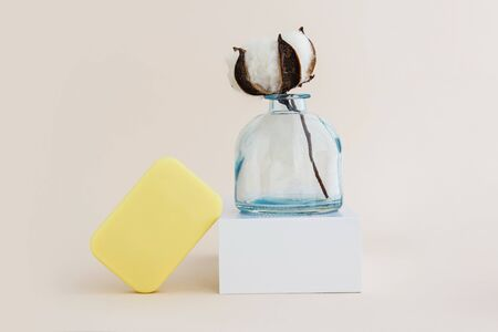 Soap and cotton flower. Minimal organic and zero waste cosmetics concept. Monochrome. Imagens