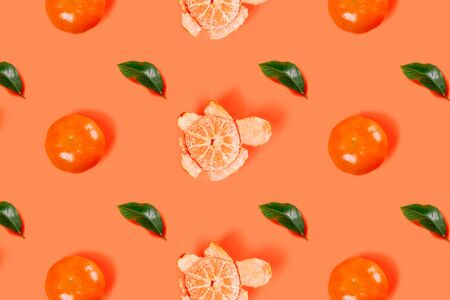 Mandarin pattern on bright orange background. Minimal flat lay concept. Top view.