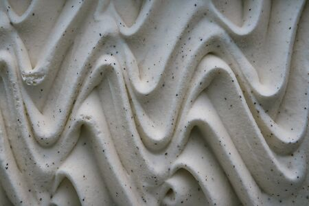 Closeup of tasty vanilla ice cream background. Close up wavy texture, top view.