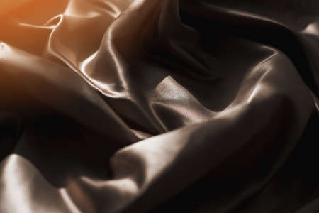 Brown atlas or silk fabric background, texture.