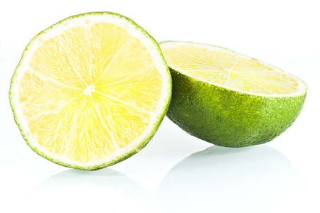 lime blossom: fresh delicious sour halves of lime isolated on white background Stock Photo