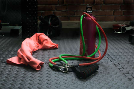 Training rubbers together with pink water bottle and towel. At the bottom more training elements like rollers