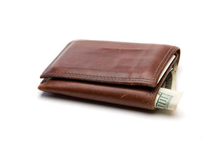 billfold: Well worn brown leather billfold with $100 bill sticking out.