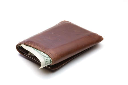 Well worn brown leather wallet with one hundred dollar bill sticking out and isolated on a white background. photo