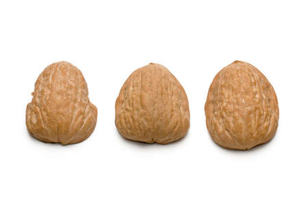 A traditional shell game with three walnut shells Imagens