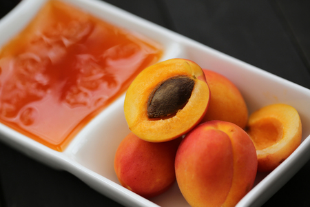 Apricot jam with fresh fruit Фото со стока