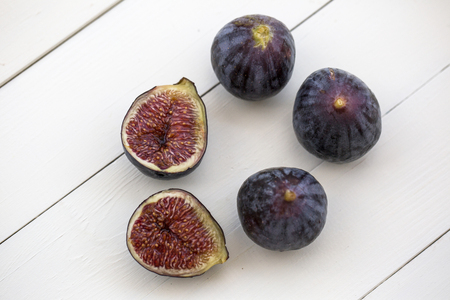 figs on white wooden ground