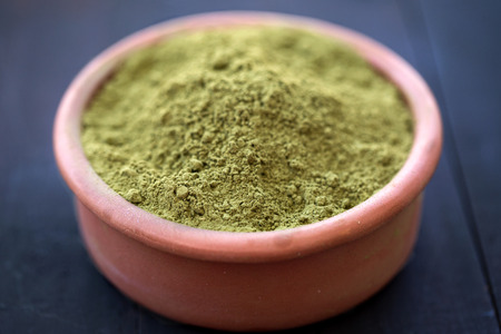 Henna powder in a bowl