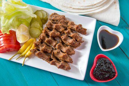 Cig kofte ,Turkish Traditional food made with bulgur and raw meat Banco de Imagens