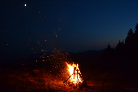forest fire in mountains against the moon photo