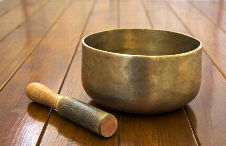 tibet bowls: Metal singing bowl on a wooden surface