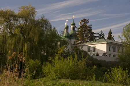 midst: Church temple in the midst of green forests Stock Photo