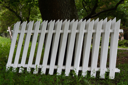 several sections of the white wooden fence Stock Photo