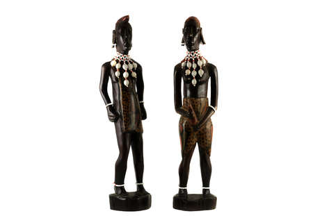 african statuettes on white background photo