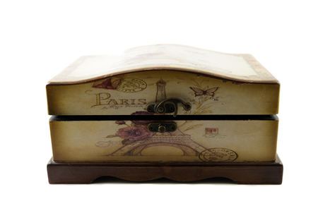 Old-fashioned half-opened wooden old casket isolated over white background photo