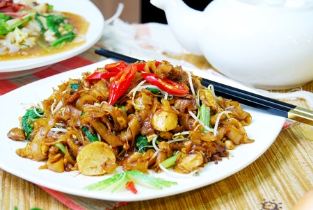 meats: chinese style noodle with vegetables, seafood and meats.
