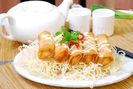 fried spring roll with mayonaise on top. photo