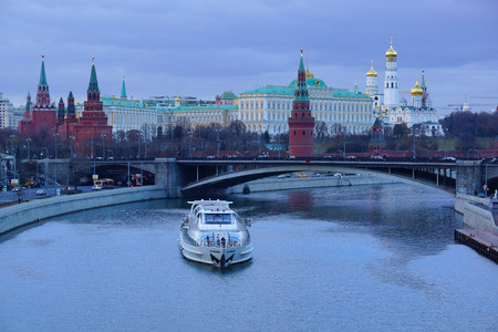 Panorama of the Moscow Kremlin.pleasure boat and a Large Stone Bridge. photo