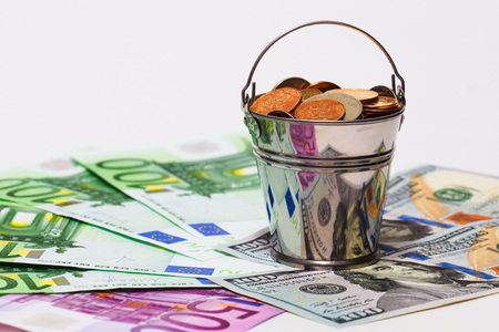 bucket of money: Euro banknotes, dollars and bucket with Russian money