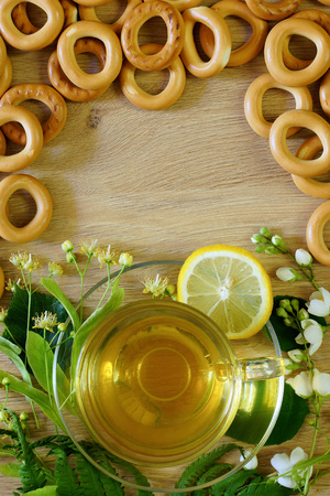Tea drinking. Herbal tea in a transparent cup and bagels. Congratulatory background.