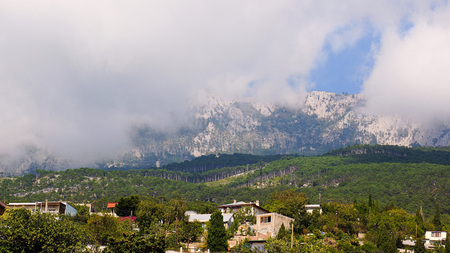 Landscapes Crimea. Clouds descended on the mountains. Alupka, Ay-Petri platea. Stock Photo