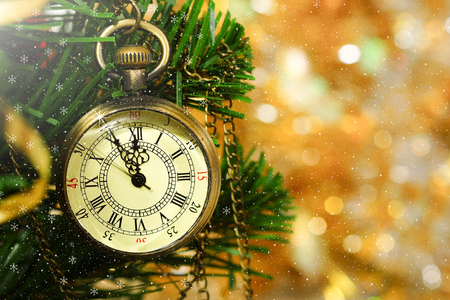 New Year. Congratulatory Christmas background with a clock on the Christmas tree.