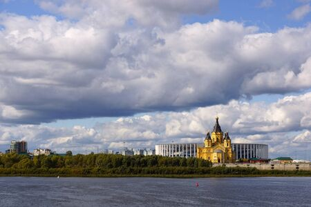 Nizhny Novgorod, Russia - September 15, 2019. View of the Alexander Nevsky Cathedral and the new stadium from the side of the Nizhny Novgorod Kremlin. Landscape with thunderclouds Foto de archivo